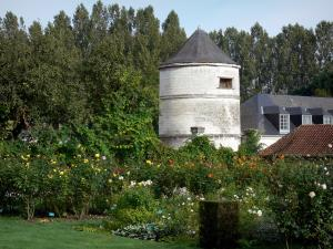 Valloires gardens - Dovecote of the Valloires Cistercian abbey, rose garden and trees