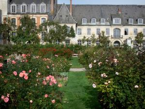 Valloires gardens - Rose garden, trees and Valloires Cistercian abbey