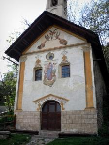 Vallouise - Facade of the Penitent chapel with painted murals