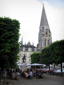Vendôme - Romanesque bell tower of the Trinité abbey and Saint-Martin square with a café terrace, a statue of Rochambeau and trees