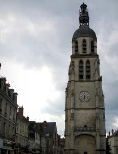 Vendôme - Saint-Martin tower (isolated bell tower), houses of the Saint-Martin square and cloudy sky