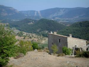 Verdon Regional Nature Park - Stone house in the village of Bargème, shrubs and hills covered with forests