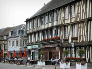Verneuil-sur-Avre - Facades of half-timbered houses and café terrace of the Place de la Madeleine square