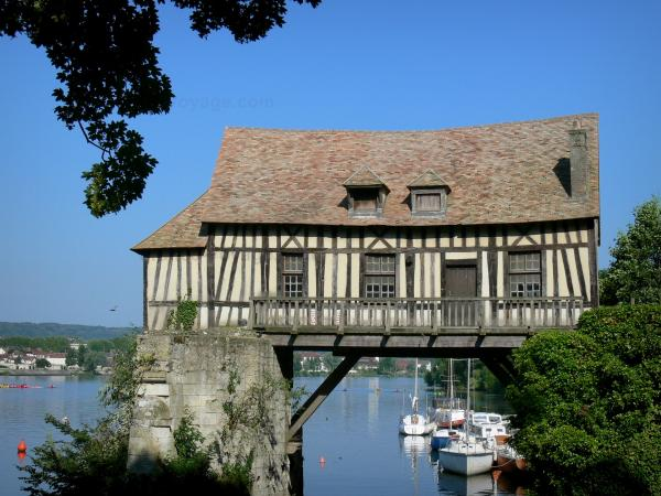 Vernon - Old half-timbered mill mounted on the piles of the old medieval bridge, River Seine and boats