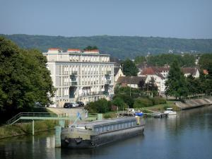 Vernon - River Seine, moored barge, building and houses of the town