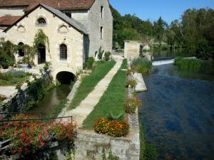 Verteuil-sur-Charente - Water mill and its garden decorated with flowers, the Charente river (Charente valley), trees along the water