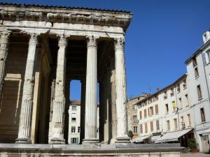 Vienne - Auguste and Livie temple (Roman temple) with Corinthian columns and facades of the Place du Palais square