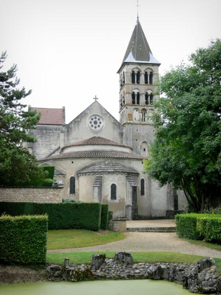 Vignory church - Apse and bell tower of the Saint-Étienne Romanesque church, and garden