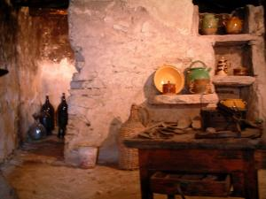 Village des Bories - Inside of a hut with traditional objects (rural settlement museum)