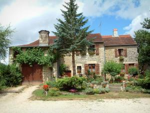 Villages of the Haute-Saône - Stone house and its garden featuring trees, flowers and plants