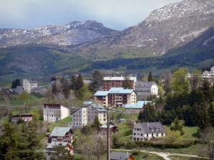 Villard-de-Lans - Houses and buildings of the winter and summer sports resort (ski resort), forest and mountains; in the Vercors Regional Nature Park (Vercors mountains)