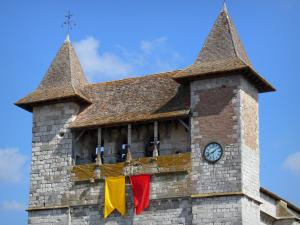 Villeréal - Medieval bastide town: towers and clock of the fortified Notre-Dame church