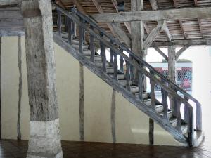 Villeréal - Medieval bastide town: staircase and wooden pillars of the covered market hall