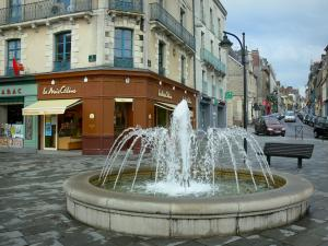 Vitré - Fountain, shops and buildings of the city