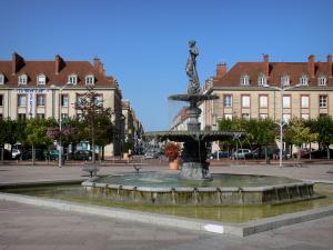 Vitry-le-François - Armes square: fountain with the statue of the River Marne called Déesse, trees and buildings of the city