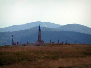 Vosges massif - Statue of Virgin at the top of the Alsace Ballons with a view of mountains covered with forests (Ballons des Vosges Regional Nature Park)