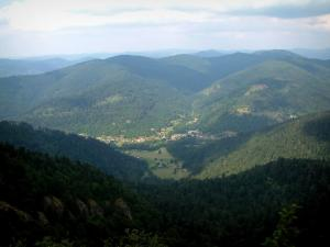 Vosges massif - Village surrounded by mountains covered with forests (Ballons des Vosges Regional Nature Park)