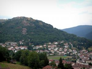 Vosges massif - Houses of a village and hills covered with forests (Ballons des Vosges Regional Nature Park)