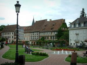 Wissembourg - Park with a lamppost, fountains, benches, lawns and flowers, old houses