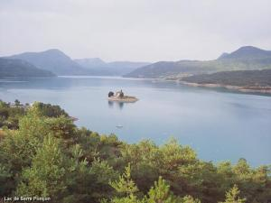 Lac Serre Poncon : France chapel on island sits in lac serre poncon zoom out stock